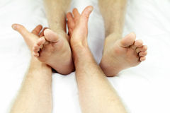 Feet Treatment. Man getting ankle rolling as part of a reflexology session from a male massage therapist royalty free stock images