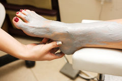 Feet treatment. Full Body Wrap Detail, feet treatment and massage Royalty Free Stock Photos