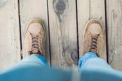 Feet trekking boots hiking Traveler alone outdoor wild nature Li Royalty Free Stock Image