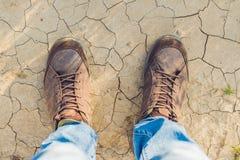 Feet trekking boots hiking Traveler alone outdoor wild nature Li Stock Image