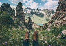 Feet trekking boots and mountains landscape on background Travel Lifestyle adventure. Vacations concept Stock Photos