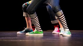 Feet of a trio of hip-hop performers. In colorful sneakers Royalty Free Stock Photos
