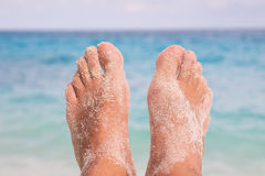 Feet on Tropical Beach Stock Images