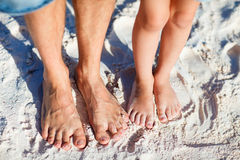 Feet on tropical sand Royalty Free Stock Images