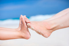 Feet on tropical sand Royalty Free Stock Photos