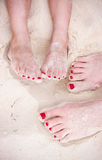 Feet on tropical sand Stock Photos