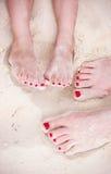Feet on tropical sand Stock Photos