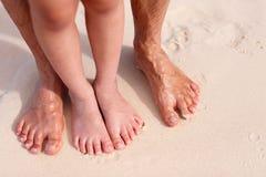 Feet on tropical sand Royalty Free Stock Photos