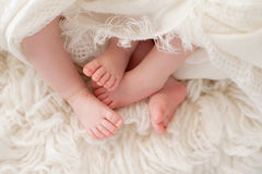 Feet of Twin Baby Girls Stock Photos