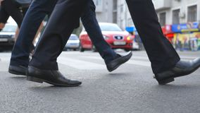Feet of two businessmen walking in city street. Business men commute to work together. Confident guys being on his way. To office. Legs of colleagues going stock video