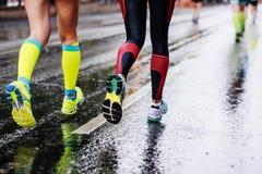 Feet two girls athletes running Stock Photos