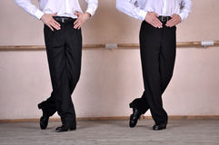 Feet of two Irish dancers. A black choreography dancers dances dancing feet footwear irish men of pair position the trousers two Royalty Free Stock Photo