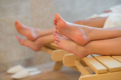 Feet of two women relaxing spa room Royalty Free Stock Photo
