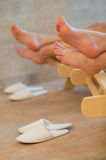 Feet of two women resting spa room Royalty Free Stock Photo