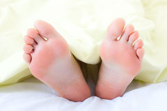 Feet under blanket Royalty Free Stock Photography