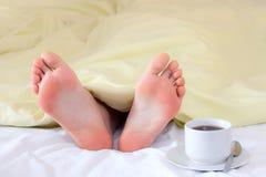 Feet under blanket Stock Photography