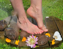 Feet under cold water Kneipp Stock Images