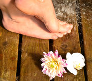 Feet under cold water Stock Photos
