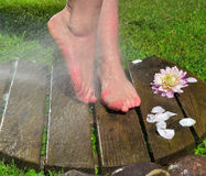Feet under cold water Royalty Free Stock Photos