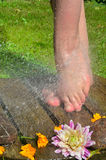 Feet under cold water Stock Photo