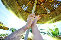 Feet under the umbrella Royalty Free Stock Photo