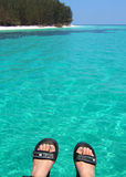Feet up. Looking across clear blue seas with feet in in the foreground Royalty Free Stock Photo