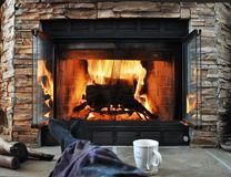 Relaxing in front of a fireplace stock images
