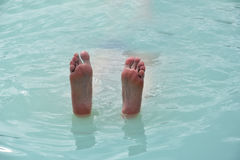 Feet up out the water Stock Photography