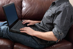 Feet up working from home Stock Photography