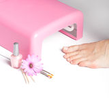 Feet and uv lamp for nails Stock Images