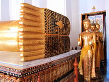 Feet view of recline Buddha statue, show Thai ancient universe. Stock Image