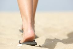 Feet walking in flip flops on beach Stock Photography