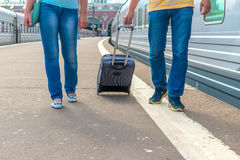 Feet walking on the platform passengers. With a suitcase Stock Photos