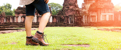 Feet walking to ancient temple with gradient light Stock Photo