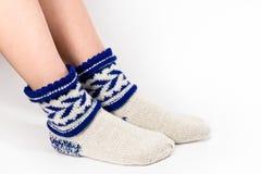 Feet warm socks. On white background Royalty Free Stock Photos