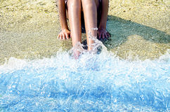 Feet washed in ocean wave Stock Photo