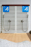 Feet washing outdoor showers. Stock Images