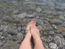 Feet in the water. Cool off your feet in sea water Royalty Free Stock Photos