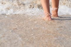 Feet in water closeup Stock Photos