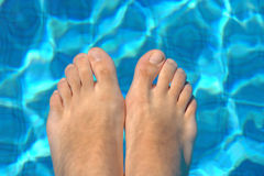 Feet in water on swimming pool Royalty Free Stock Photos