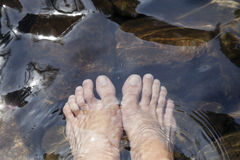 Feet in waterfall , at phangnga thailand. Stock Photography