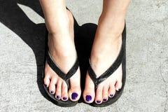 Feet wearing flip flops Royalty Free Stock Images