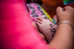 Feet wearing Henna Stock Photo