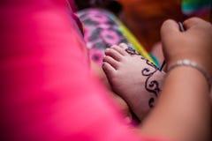 Feet wearing Henna Stock Photo