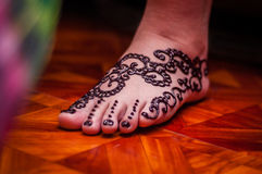 Feet wearing Henna Stock Photography