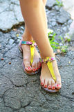 Feet wearing summer sandals Royalty Free Stock Images