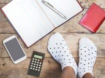 Feet wearing white polka dot socks. Selfie feet wearing white polka dot socks on wooden floor background Stock Photography