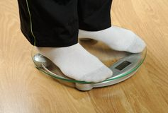 Feet on weight scale Stock Photos