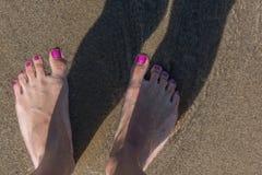 Feet on the sand stock photos