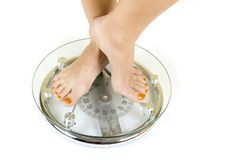 Feet on white glass scale Stock Image